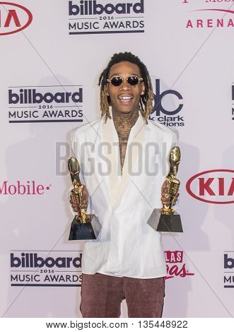 LAS VEGAS - MAY 22 : Recording artist Wiz Khalifa poses in the press room at the 2016 Billboard Music Awards at T-Mobile Arena on May 22 2016 in Las Vegas Nevada.