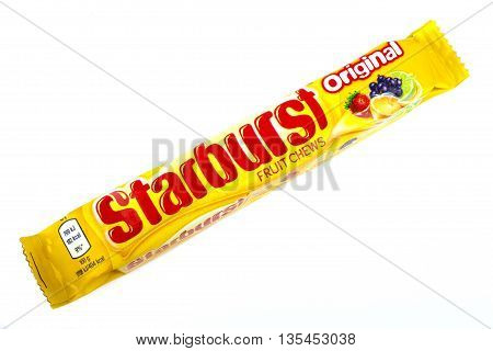 LONDON UK - JUNE 16TH 2016: An unopened pack of Starburst Fruit Chews pictured over a plain white background on 16th June 2016. The Chews are manufactured by Quadir company a subsidiary of Mars Incorporated.