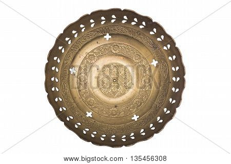 Antic engraved decorative perforated metal plate in oriental style with incused eastern pattern on isolated background