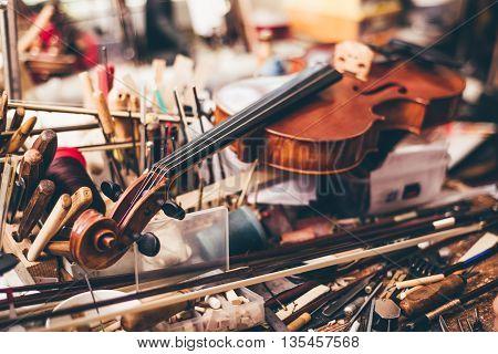 Close up of violin luthier workshop in background