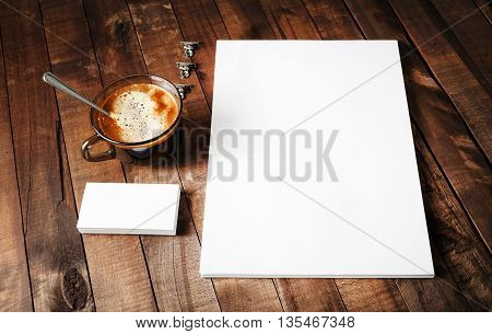 Blank paper letterhead coffee cup and business cards. Blank paperwork template. Blank stationery set on vintage wooden table background. Mock-up for design portfolios.
