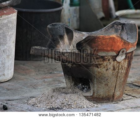 Cooking jar with ashes in temple grounds at Luang Prabang Laos.