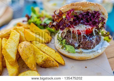 Tasty grilled cretan beef burger with lettuce and  french fries