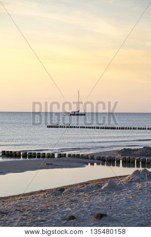 sunset with anchoring sailing boat in summer