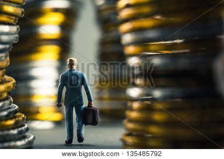 Businessman walking on the road, surrounded by money
