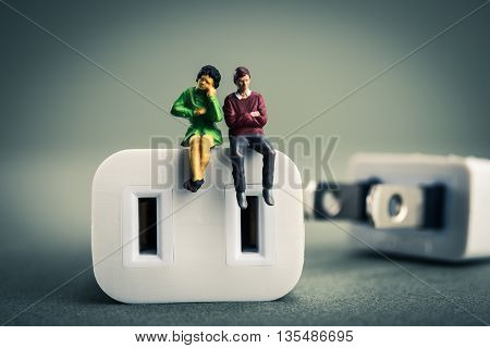 Men and women suffering , electrical outlet