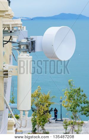 communication transmitter on the building satellite dish