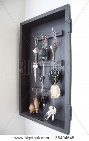 Key on hanger in a wooden key-box