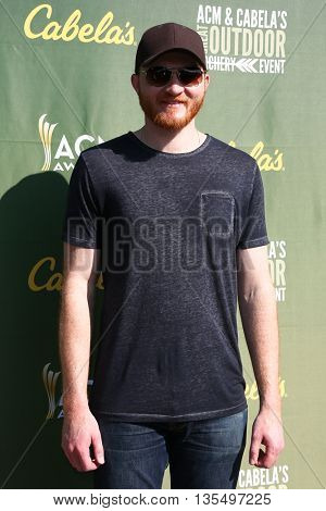 ARLINGTON, TX - APR 18: Recording artist Eric Paslay attends the ACM & Cabela'??s Great Outdoor Archery Event at the Texas Rangers Youth Ballpark on April 18, 2015.