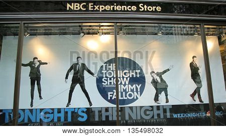 NEW YORK - JUNE 16, 2016: NBC Experience Store window display decorated with The Tonight Show with Jimmy Fallon logo in Rockefeller Center in Midtown Manhattan
