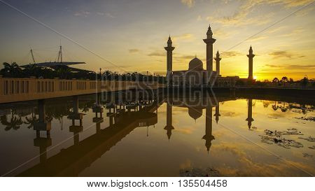 Reflection of a modern beautiful mosque during blue hour sunrise in Shah Alam Malaysia. Noise slightly visible due to high iso and long exposure.