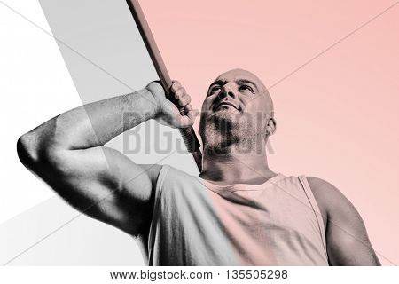 Athlete preparing to throw javelin against colored background