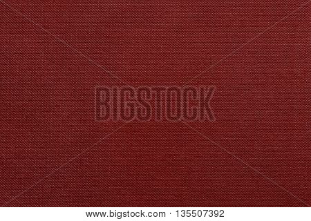 the grooved textured design of fabric with pile for the abstract background and for wallpaper of red color