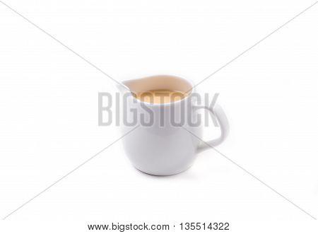 White Jar of Sweetened condensed milk isolated on white background.