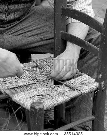 Old Man Mender Of Chairs While Repairing Old Wooden Chair
