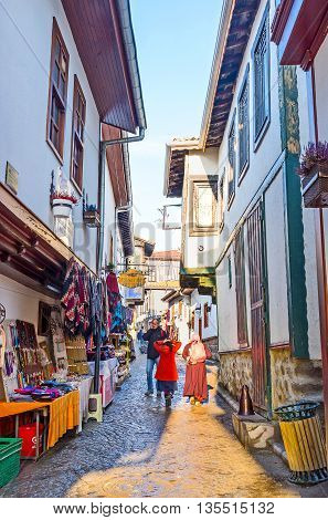 ANKARA TURKEY - JANUARY 16 2015: The narrow streets on the way to the Castle Hill are the best place for the souvenir stalls and local market on January 16 in Ankara.