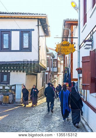 ANKARA TURKEY - JANUARY 16 2015: The narrow streets of the Turkish village in old Ankara are full of tourists climbing on the Castle Hill to discover the medieval landmark on January 16 in Ankara.