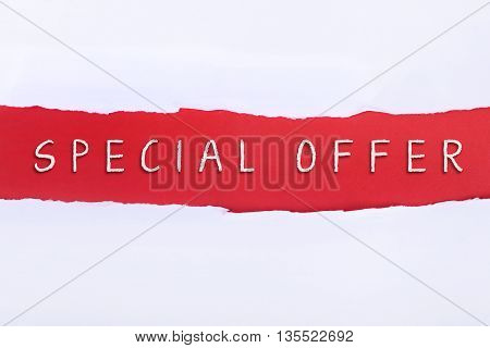 Torn paper with a SPECIAL OFFER word on red background.
