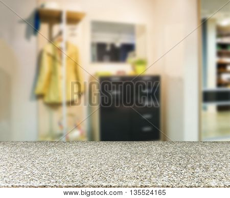 Marble empty table in front of blurred background. Perspective marble deck over blur in modern apartment interior. Mock up for display or montage your products
