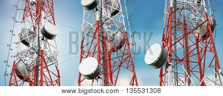 Telecommunication towers with TV antennas and satellite dish on blue sky, panorama