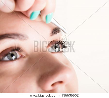 Beautiful young woman eyelash extension. Woman eye with long eyelashes. Beauty salon concept.