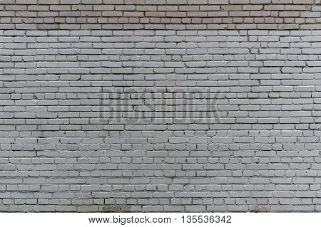 Wall from a white silicate brick. The irregular texture of the brickwork.