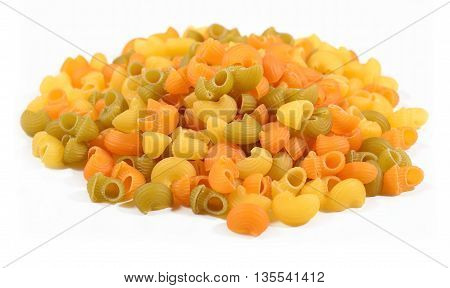 Heap Of Colored Uncooked Italian Pasta Pipe Rigate On A White