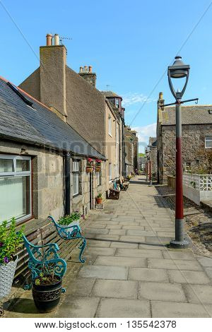 A narrow street in the small village of Footdee (aka Fittie). A nineteenth century fishing village close to entrance of Aberdeen harbour.