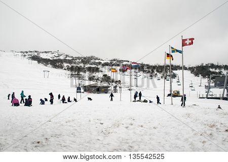 Smiggins Hole, Perisher Valley - 23 June 2016: School children having fun in the snow at Smiggins Hole