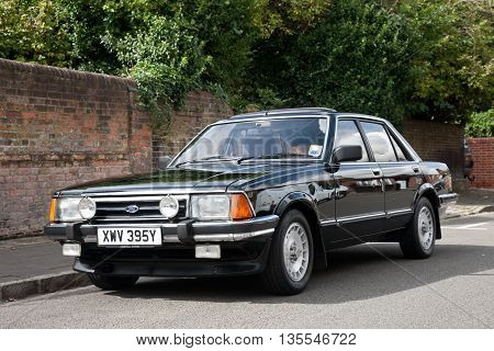 AMERSHAM, UK - SEPTEMBER 13: A vintage Ford Granada motorcar is parked on the side of the public highway during the annual Amersham Heritage day festival on September 13, 2015 in Amersham.
