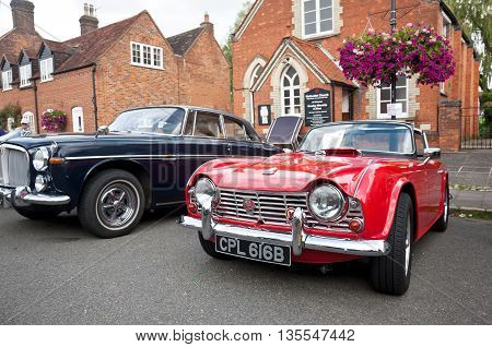 AMERSHAM, UK - SEPTEMBER 13: A vintage Triumph TR4 sportscar is parked on the side of the public highway as a static display at the Amersham Heritage Day festival on September 13, 2015 in Amersham.