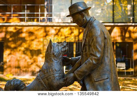 TOKYO JAPAN - NOVEMBER 28 2015: Hachiko with Dr. Hidesaburo Ueno statue at Tokyo University Todai campus the dog is remarkable loyalty to his owner which continued for ten years after his owner's death