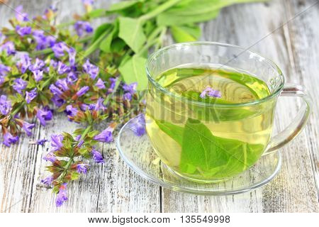 Glass of sage herbal tea. Decorated with flowering sage lat. Salvia officinalis