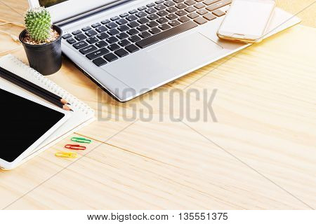 Office desk table with laptop computer note book and smart phone. Top view with copy space