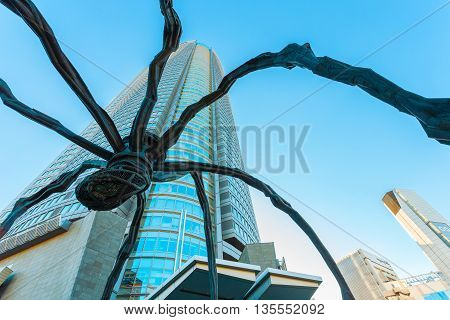 TOKYO JAPAN - NOVEMBER 28 2015: Maman - a spider sculpture by Louise Bourgeois situated at the base of Mori tower building in Roppongi Hills
