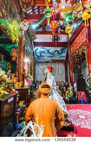 Thanh Hoa, Vietnam - October 19, 2014: A male medium performs Len Dong, a spirit mediumship ritual in Central Vietnam. In trance the medium channels gods and goddesses of the Dao Mau religion.