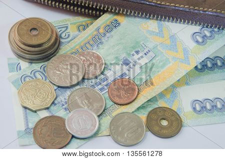 Financial investments across different currencies.Wallet insert currency of the country in both Asia and Europe.