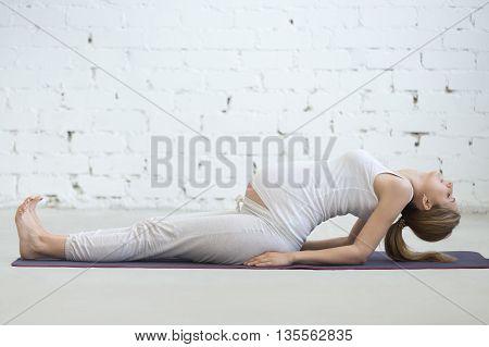 Pregnant Young Woman Doing Prenatal Yoga. Fish Pose