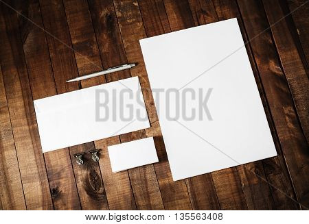 Blank stationery set. Blank corporate identity template on vintage wooden table background. Blank letterhead business cards envelope and pen. Mock-up for branding identity.