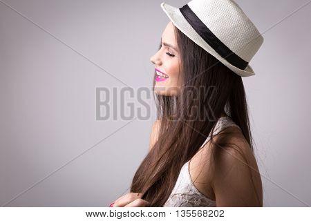 Portrait of a beautiful latina girl wearing white dress