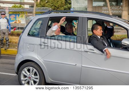 QUITO, ECUADOR - JULY 7, 2015: Pope Francisco in a grey car saying hello to people on the streets, body guards with him.