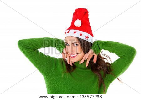 A photo of happy young woman wearing Santa hat. Beautiful female is in green turtleneck sweater. She is standing isolated on white background.