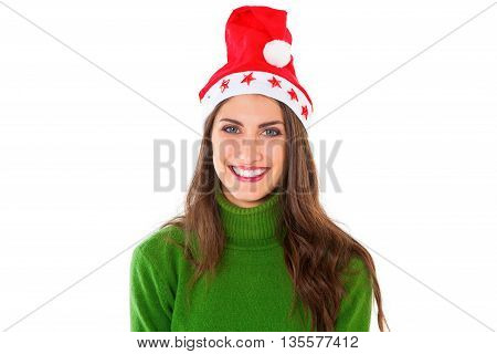 A photo of attractive young woman wearing Santa hat. happy female is in green turtleneck sweater. She is standing isolated on white background.