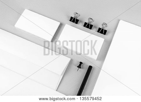 Photo of blank stationery set. Blank corporate identity template. Blank stationery with soft shadows on gray background.. ID template. Mockup for branding identity for designers. Top view.