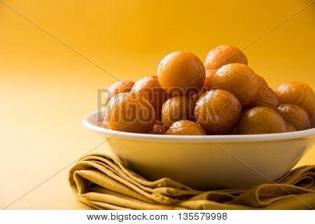 poster of Gulab jamun, or gulaab jamun, is a milk-solids-based sweet mithai