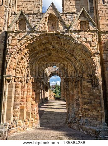 Arch in th ruins of Jedburgh Abbey in the Scottisch Borders region in Scotland