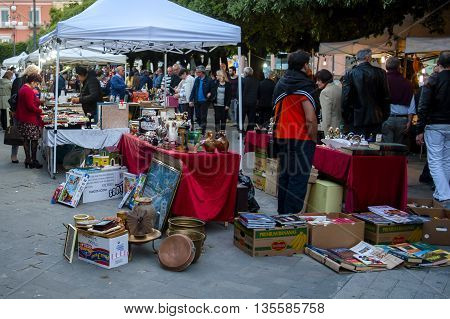 Trani Italy - May 22 2016: flea market vintage items for sale on the main square