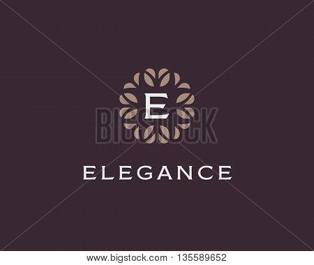 Premium monogram letter E initials logo. Universal symbol icon vector design. Luxury abc leaf logotype