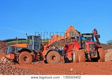 Tractor and front loader on a construction site