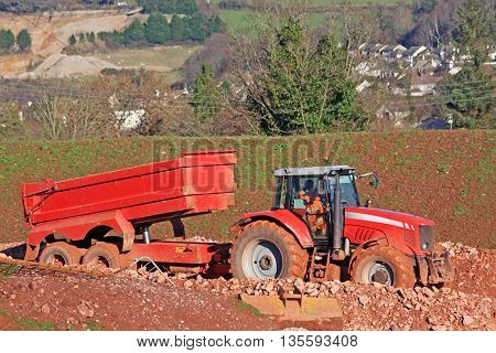 Tractor and tipper trailer on a construction site
